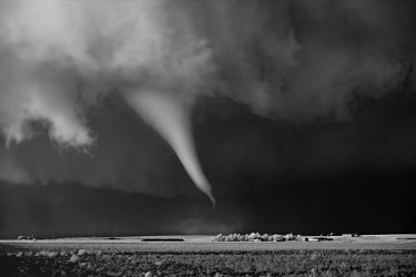White tornado above farm