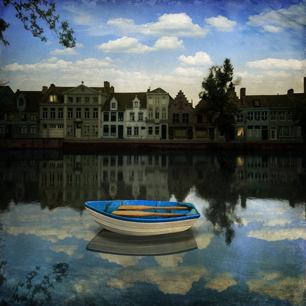 Photomontage by Maggie Taylor showing a small boat in a castle, it makes the viewer feel like being in a fairytale.